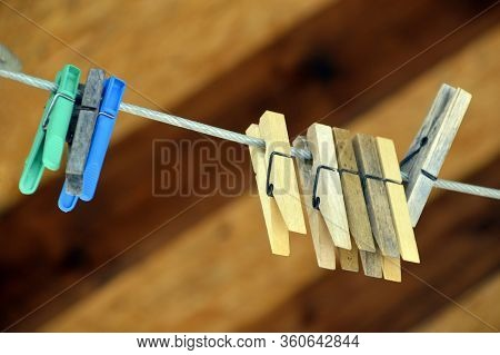Concept Love And Togetherness Without People. Clothespins On A Rope On A Wooden Background. Middle C