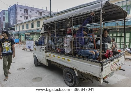 Bangkok, Thailand - February 27th, 2020: A Truck Loaded With Workers And Equipment On A Street In Ba