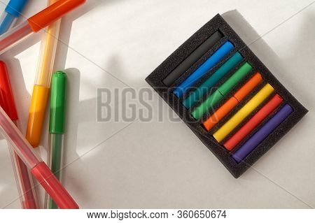 Drawing With Pastels And Felt Pens. Multi-colored Pastel Pieces In A Package And Felt Pens.