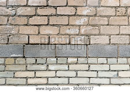 The Building Wall Is Made Of White Silicate Bricks And Cinder Blocks. Texture For Background