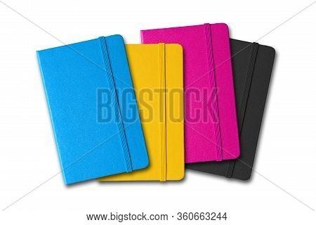 Cmyk Closed Notebooks Set Isolated On White