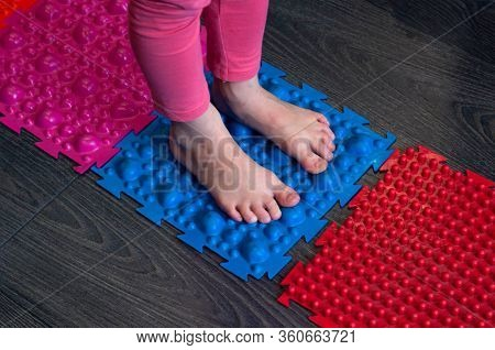 Barefoot Girl Walks On Sensory Mats In The Sensory Integration Room