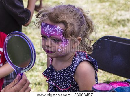 Young Girl With Her Face Painted Like A Princess