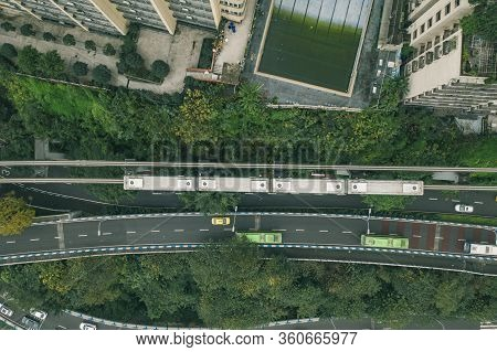 Aerial Drone Overhead View Of Chongqing Light Rail Carriage On Rail To Liziba Transit Along Resident