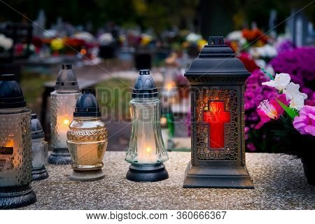 Lanterns And Candles On The Grave Devoted To All Souls Day