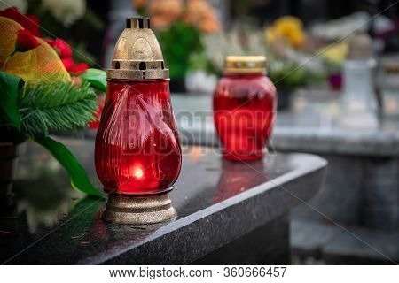 Red Candles On The Grave Devoted To All Souls Day