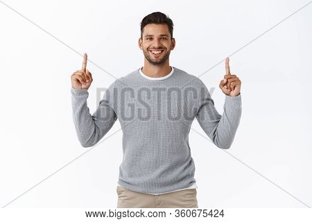 Confident, Friendly Attractive, Charismatic Bearded Man Smiling Satisfied And Cheerful, Pointing Fin