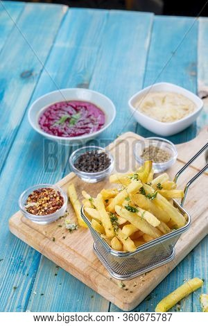 Fries Potato In Basket With Hommos And Red Hommos, Fried Potato With Spices And Arabic Hommos / Humm