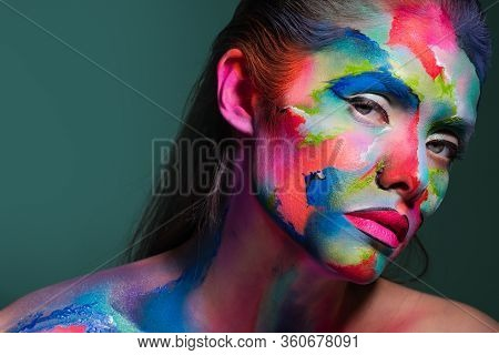 Face Art And Creative Makeup, A Young Beautiful Woman Abstract Art On The Face, An Unusual Idea.