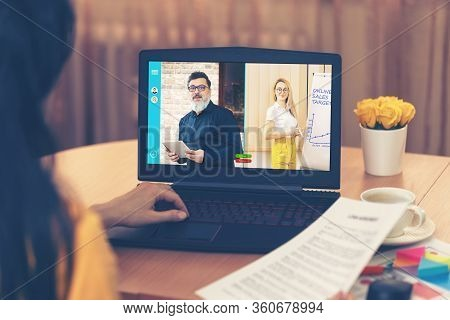 Back View Of Business Woman Talking To Colleagues About Online Sales Plan In Video Conference - Mult