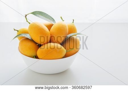 Marian Plum Or Plango In White Bowl On White Table
