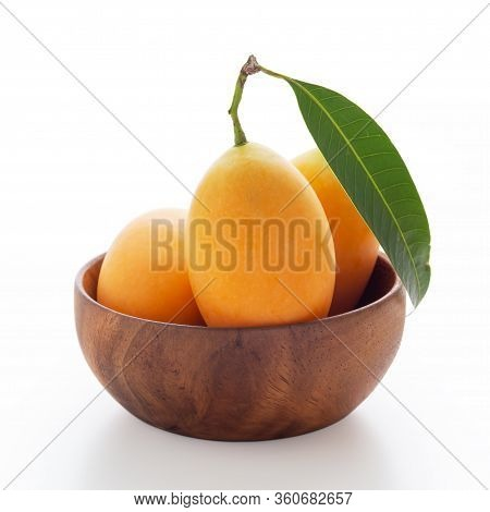 Marian Plum In Wooden Bowl Isolated On White Background