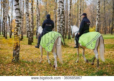 Mounted Police In Autumn City Park, Back View. All Cops Are Bastards Acronym, Anarchism Movement Con