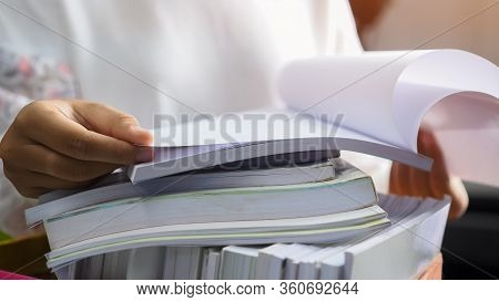 Stacks Of Paper Files For Searching Information On Work Desk Office By Businesswoman Hands Working,