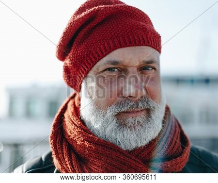 Charismatic Senior Grey Haired Man Expressing Calmness While Looking At You With Shrewd Glance. Man