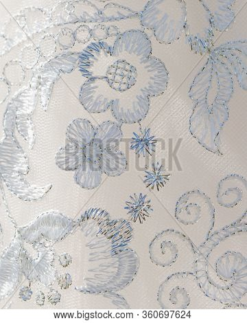 Close Up Of Wedding Bridal Gown Showing Lace Floral Embroidery Detail On Dress