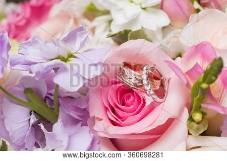 Wedding Rings In Bridal Bouquet