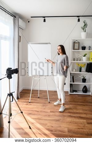 Educational Video Blogging, Studying Online. Young Woman Records Video Lessons On Camera, She Stands