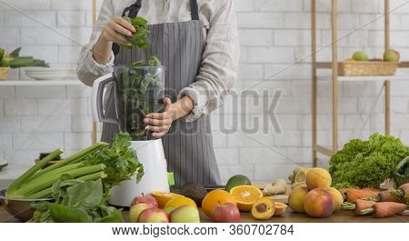 Healthy Eating, Cooking, Vegetarian Food. Young Woman With Blender Chopping Green Vegetables For Det