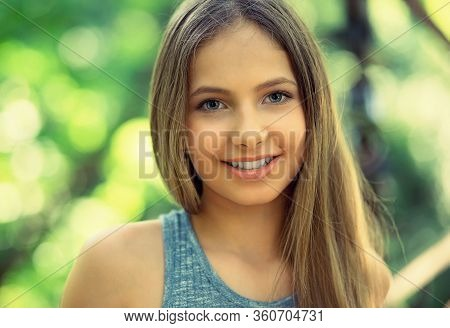 Smile. Portrait Of A Young Beautiful Smiling American Woman, Sunshine Girl Isolated Green Outdoors P
