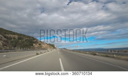 Greek Empty Highway Without Traffic And Speed Limit Sign. Day Pov View Of Car Speeding On Multi Lane