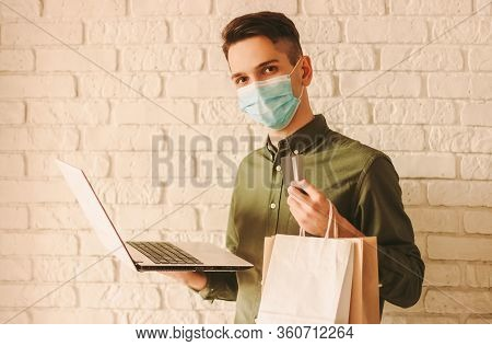 Young Hipster In Medical Face Mask Shopping At Online Internet Store. Happy Man In Protective Face M