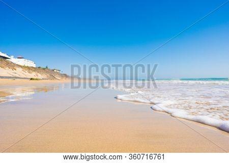 Sandy beach and calm sea in the Canary Islands
