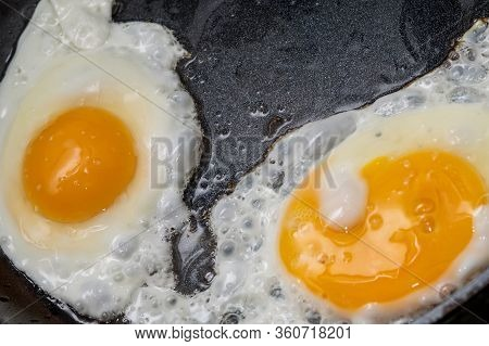 Fried Eggs In A Pan. Fried Two Eggs. Cook An Omelet In A Pan Three Yolks. Fried Eggs For Breakfast C