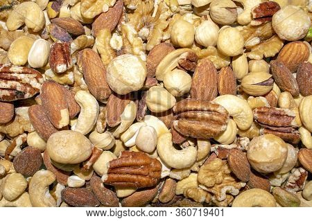 Background Made Of Mixed Nuts. Healthy Snack And Food. Salted And Spicy Pistachios, Cashew, Pecan, W