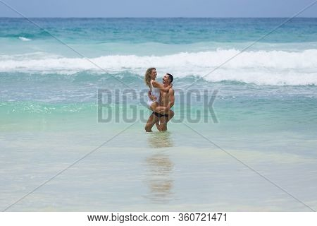 Beautiful Loving Married Couple Enjoy Their Vacation Together At Tropical Beach In Seychelles.
