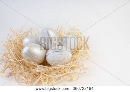 Happy Easter Card. Colorful Shiny Eggs In A Nest Isolated On A White Background. Copy Space For Text