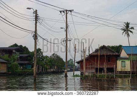 Stilt Houses At A Klong In Bangkok. Klongs Are The Canals, That Branch Off From Chao Phraya River, T