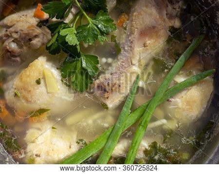 The Surface Of The Soup, Cooked On Chicken Broth. Chicken Drumsticks, Potatoes, Carrots And Vermicel