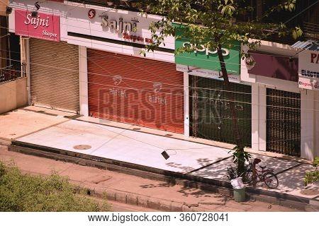 Mumbai, Maharashtra / India - 22 March 2020: City Lockdown With Shops, Store Fronts Closed Amid Fear