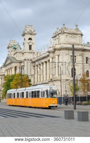 Budapest, Hungary - Nov 6, 2019: Yellow Tram In Front Of The Museum Of Ethnography Building From The