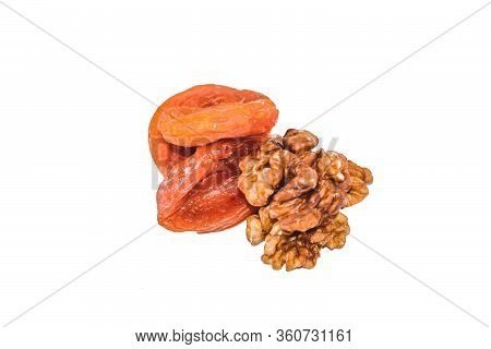 Close Up View Of Walnut And Dried Apricots Isolated On White. Heap Of Walnut And Dried Apricots As B