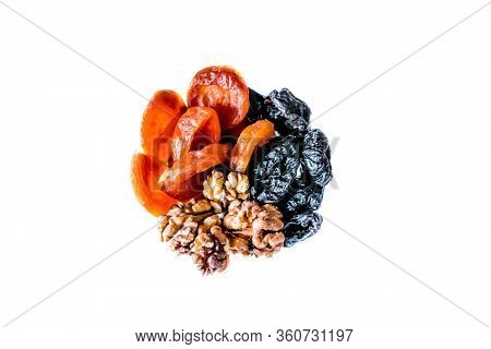 Close Up View Of Walnut, Prunes And Dried Apricots Isolated On White. Heap Of Walnut And Dried Fruit