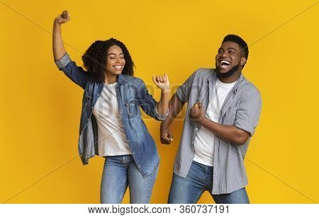 Dance Fun. Cheerful African American Couple Fooling Together, Dancing And Laughing, Posing Over Yell