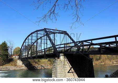 Black Steel Bridge Crosses The War Eagle River At War Eagle Mills In Northern Arkansas.  Historic Br