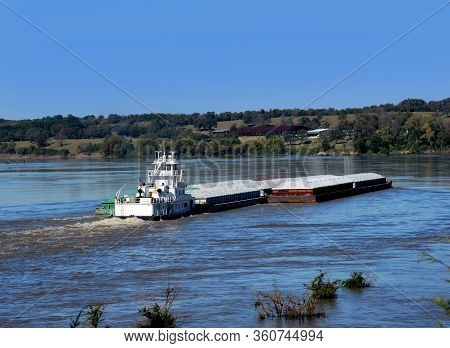 Morning Departure Has Tugboat, Also Called A Pusher, Moving Cargo Up The Mississippi River In Arkans