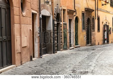 A Narrow Alley In The Center Of Rome. Medieval Buildings. Theres No One On The Street.