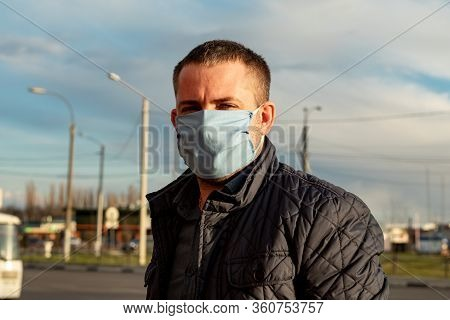 Portrait Of A Middle Aged Man Wearing A Homemade Cloth Mask During The Covid-19 Outbreak. Stop Virus