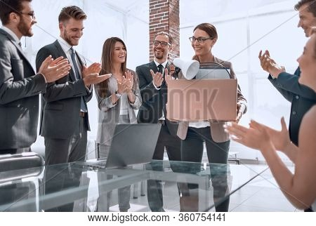 business team applauds the new employee on the first working day