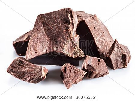 Pieces of dark chocolate with chocolate chips isolated on a white background.