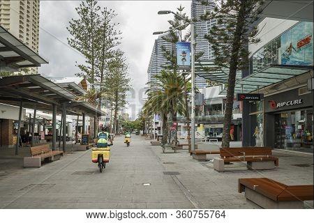Surfers Paradise, Australia - April 8, 2020: Coronavirus Standby Paramedic Ambulance On Bikes Ride T