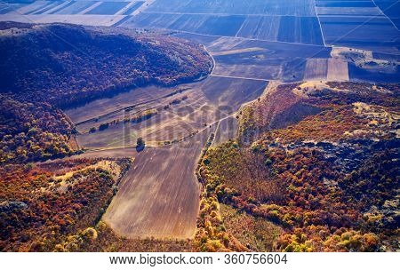 Inspirational aerial landscape, autumn forest and fields, drone point of view. Inspiring autumn landscape panorama from Dobrogea, Romania