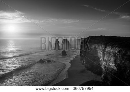 Monochrome Twelve Apostles Collection Of Limestone Stacks At Sunset Along Great Ocean Road In Port C