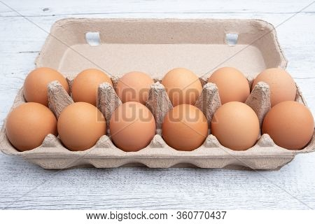 Dozen Eggs In Cardboard Package Closeup With Copy Space.