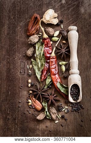 Various Whole Indian Spices On Wooden Table