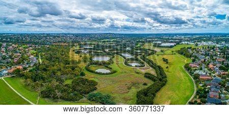 Scenic Tirhatuan Wetlands Near Suburban Areas In Melbourne, Australia - Wide Aerial Panorama